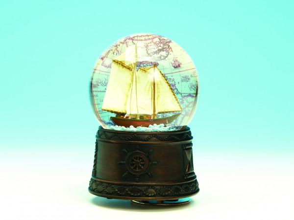 Spieluhr-Glitzerkugel mit Segelschiff und Landkarte
